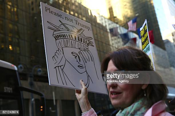 Protesters gather outside of the Grand Hyatt Hotel during a demonstration against US Republican presidential candidate Donald Trump and his racist...