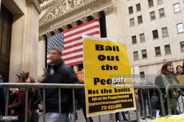 Protesters gather outside of the New York Stock Exchange October 24, 2008 in New York City. The demonstrators were frustrated with the goverment...