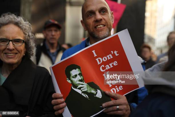 Protesters gather outside of Trump Tower a day after FBI Director James Comey was fired by President Donald Trump on May 10 2017 in New York City...