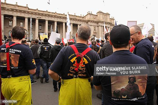 Protesters gather outside Parliament House during antigovernment rallies in Melbourne on June 12 2014 in Melbourne Australia Protestors demonstrate...