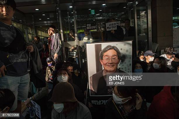 Protesters gather outside Seoul National University Hospital to stop police from retrieving the body of Baek Nam Ki for an autopsy, in Seoul on...