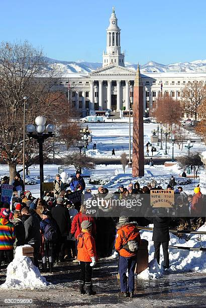 Protesters gather outside the Colorado Capitol building in Denver Colorado on December 19 2016 to demonstrate against US Presidentelect Donald Trump...