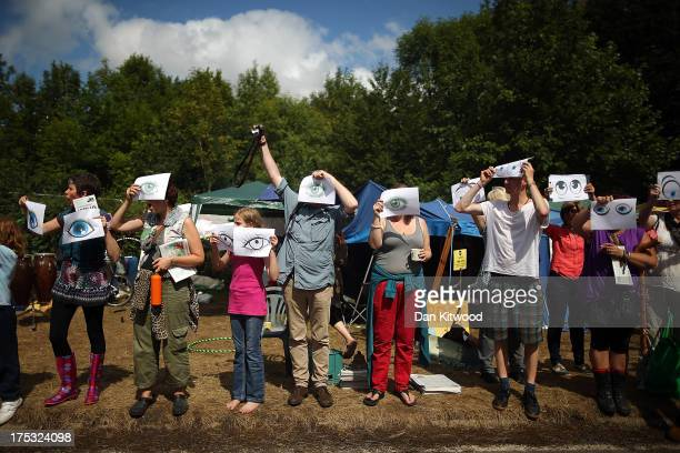 Protesters gather outside the entrance gate of a drill site operated by Cuadrilla Resources Ltd on August 2 2013 in Crawley West Sussex Protesters...