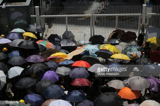 Protesters gather outside the government headquarters in Hong Kong on July 1 2019 on the 22nd anniversary of the city's handover from Britain to...