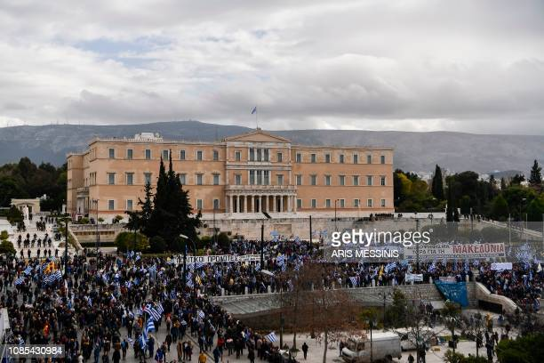 Protesters gather outside the Greek Parliament during a demonstration against the agreement with Skopje to rename neighbouring country Macedonia as...
