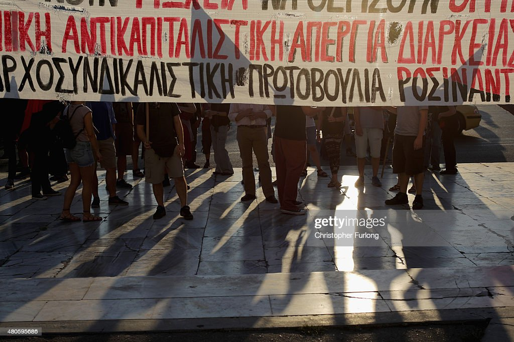 Protesters gather outside the Greek parliament to demonstrate against austerity after an agreement for a third bailout with eurozone leaders on July 13, 2015 in Athens, Greece. The bailout is conditional on Greece passing agreed reforms in parliament by Wednesday which includes streamlining pensions and rasing more raise tax revenue.