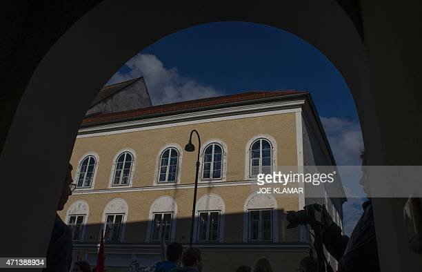 Protesters gather outside the house where Adolf Hitler was born during the antiNazi protest in Braunau Am Inn Austria on April 18 2015 The...