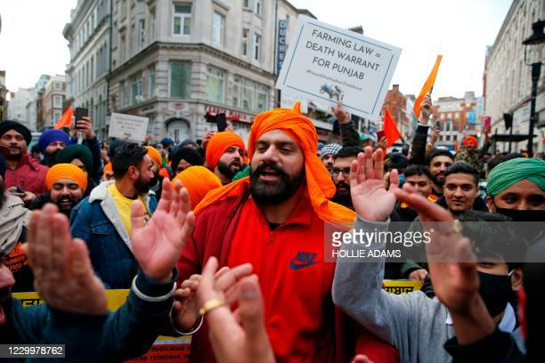Protesters gather outside the Indian High Commission in central London on December 6 as global protests against the Indian governments recent...
