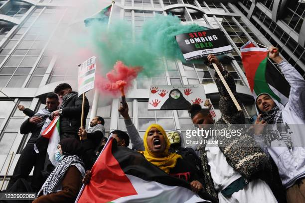 Protesters gather outside the Israeli Embassy as demonstrators show their support for Palestinians on May 15, 2021 in London, England. Several...