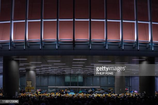 Protesters gather outside the Legislative Council in Hong Kong on July 1 2019 on the 22nd anniversary of the city's handover from Britain to China...
