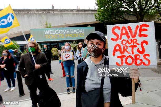 Protesters gather outside the National Theatre on the south bank to ask for fair redundancy payouts and preferential rehiring for casual staff, in...