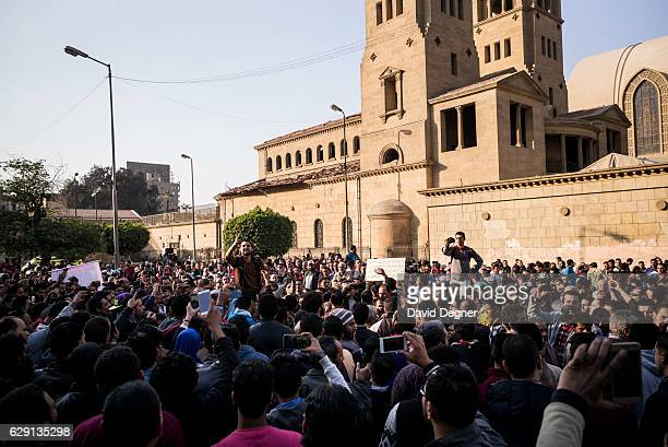 Protesters gather outside the the site of the bombing on December 11 2016 in Cairo Egypt A bomb exploded inside the Saint Mark's Coptic Orthodox...
