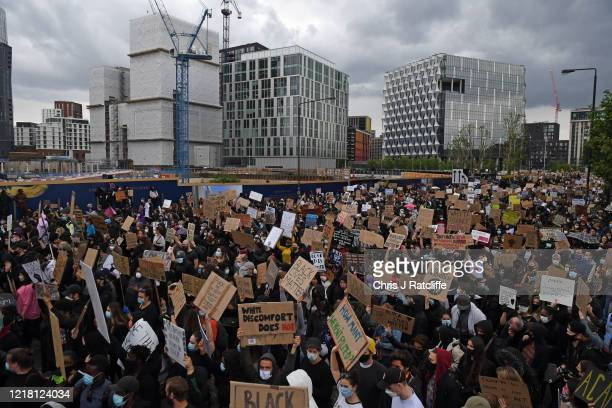 Protesters gather outside the US Embassy in Vauxhall during a Black Lives Matter protest on June 07, 2020 in London, United Kingdom. The death of an...