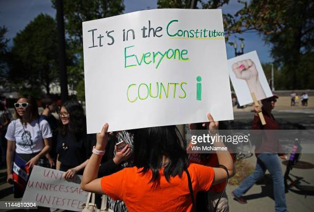Protesters gather outside the US Supreme Court as the court hears oral arguments in the Commerce vs New York case April 23 2019 in Washington DC The...
