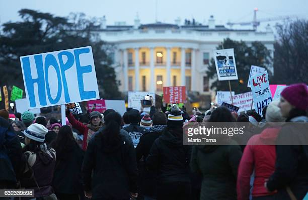 Protesters gather outside the White House at the finish of the Women's March on Washington on January 21 2017 in Washington DC Large crowds attended...
