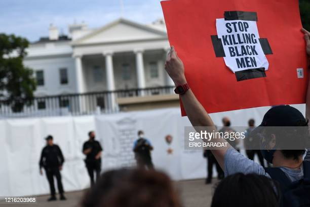 TOPSHOT Protesters gather outside the White House in Washington DC on May 29 2020 in a demonstration over the death of George Floyd a black man who...