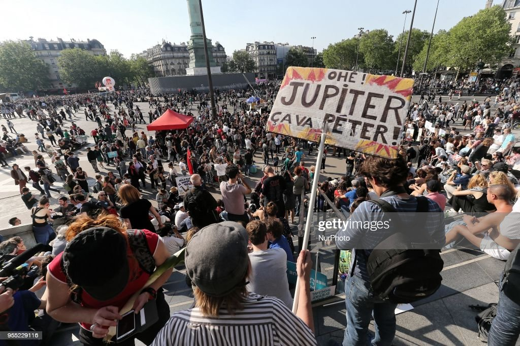 "Protesters gather Place de la Bastille during a protest dubbed a ""Party for Macron"" (Fete a Macron) against the policies of the French president on the first anniversary of his election, on May 5, 2018, in Paris."