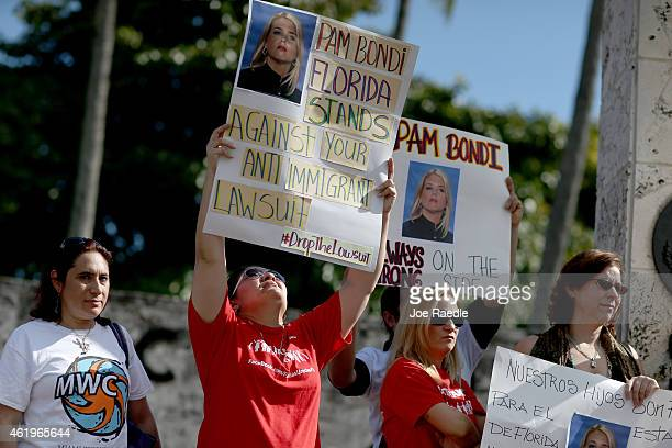Protesters gather to ask that Florida Attorney General Pam Bondi withdraw the state of Florida from the list of 25 states that joined a lawsuit...