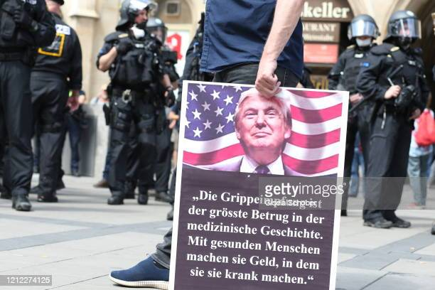 Protesters gather to demand an end to the Coronavirus lockdown measures in front of the city hall at Marienplatz on May 09 2020 in Munich Germany...