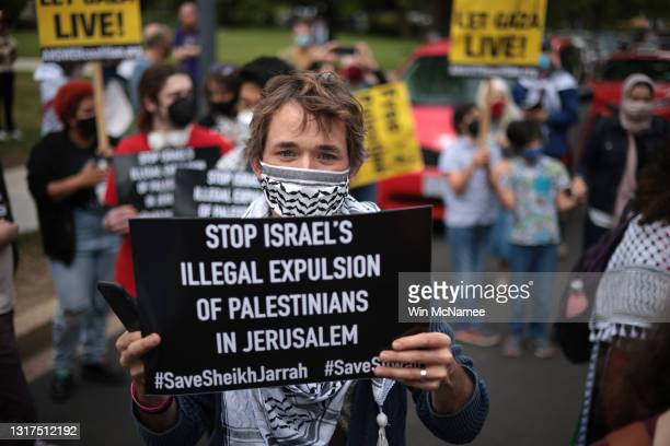 Protesters gather to demonstrate against Israel outside the U.S. State Department on May 11, 2021 in Washington, DC. Tensions in Israel continued to...