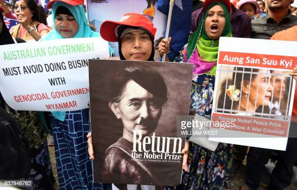 Protesters gather to demonstrate against Myanmar's State Counsellor Aung San Suu Kyi during the ASEAN Australia Special Summit in Sydney on March 17...