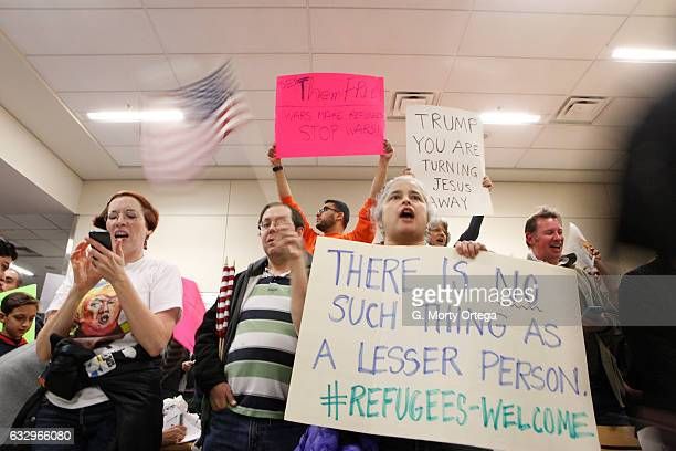 Protesters gather to denounce President Donald Trump's executive order that bans certain immigration at DallasFort Worth International Airport on...