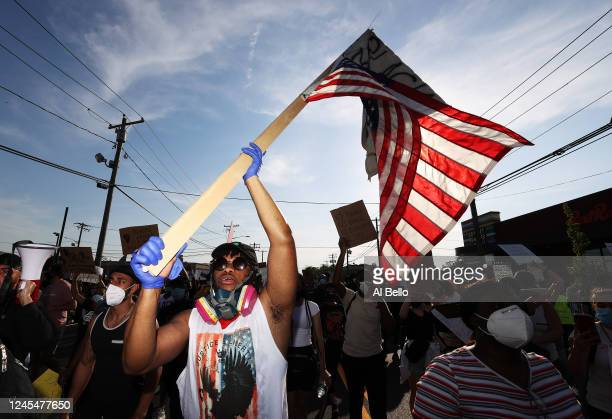 Protesters gather to march on June 04 2020 in Merrick New York Minneapolis Police officer Derek Chauvin was filmed kneeling on George Floyd's neck...