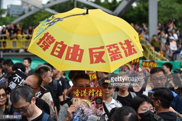 Protesters gather to take part in a march to the West Kowloon railway station where highspeed trains depart for the Chinese mainland during a...