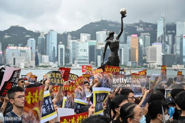 TOPSHOT Protesters gather to take part in a march to the West Kowloon railway station where highspeed trains depart for the Chinese mainland during a...