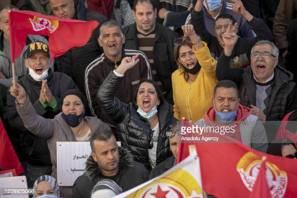 Protesters gather upon calling of Tunisian General Labour Union to stage a demonstration demanding that the ministries fulfill their reform promises...