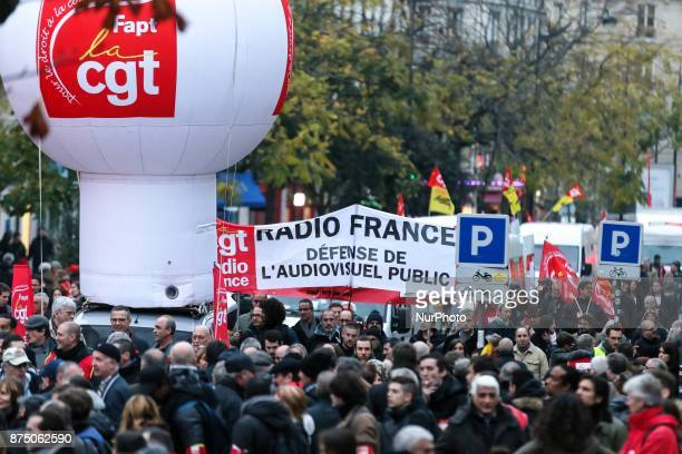 Protesters gather with balloons and banners during a demonstration as part of a nationwide protest day against the government's economic and social...