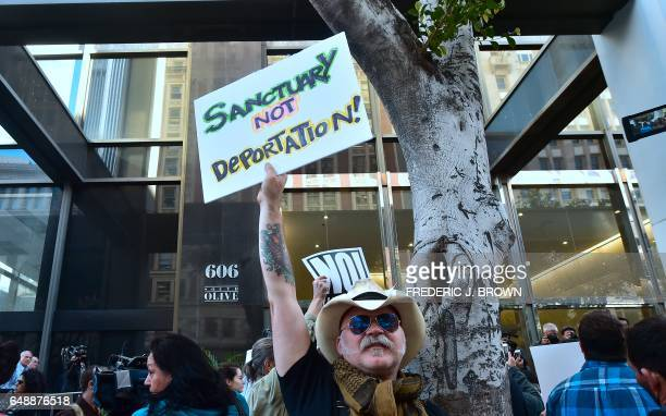 Protesters gathered in front of the Los Angeles Immigration Court building after a rally by supporters of US born daughters of undocumented Romulo...
