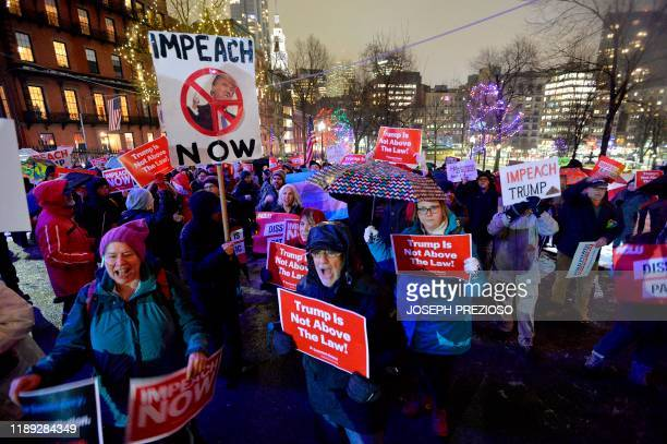 Protesters gathered on Boston Common during a rally where over a thousand people gathered in the rain and snow calling for the impeachment of...