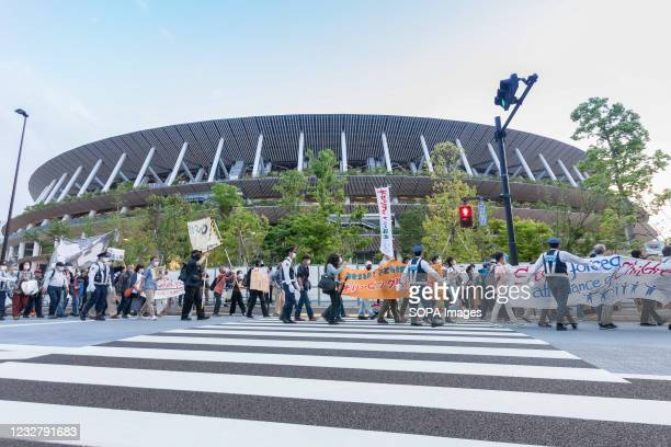 Protesters gathering outside the Olympic Stadium during the demonstration. About 100 people took part in a demo outside the Japanese Olympic...