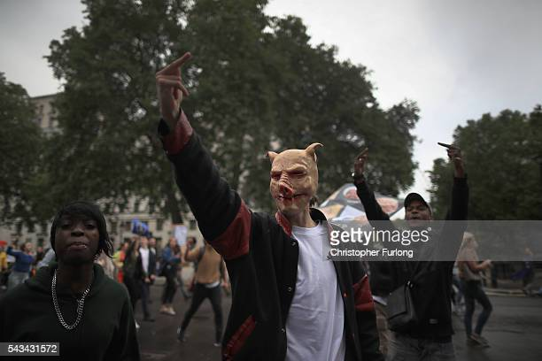 Protesters gesture to Downing St as they demonstrate against the EU referendum result on June 28 2016 in London England Up to 50000 people were...