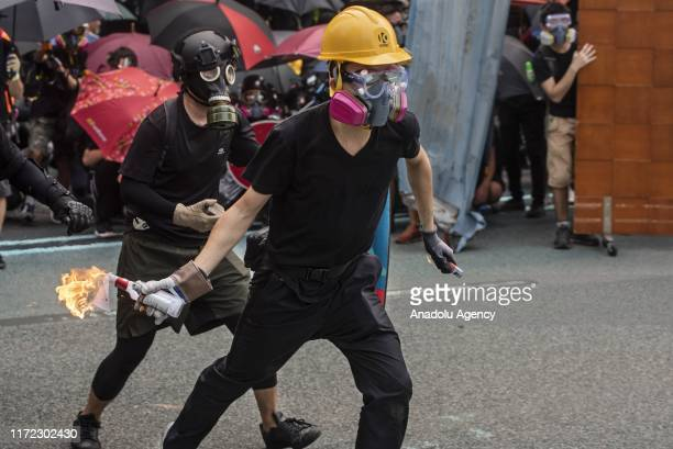A protesters gets ready to throw a molotov cocktail at the police during a rally in Hong Kong on September 29 2019 Riot police confronted and fired...
