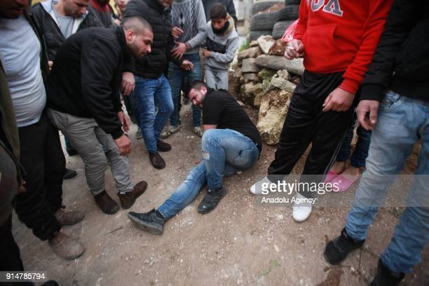 A protesters gets wounded during a protest after Palestinian Ahmed Jarrar accused of killing an Israeli settler last month was martyred by Israeli...