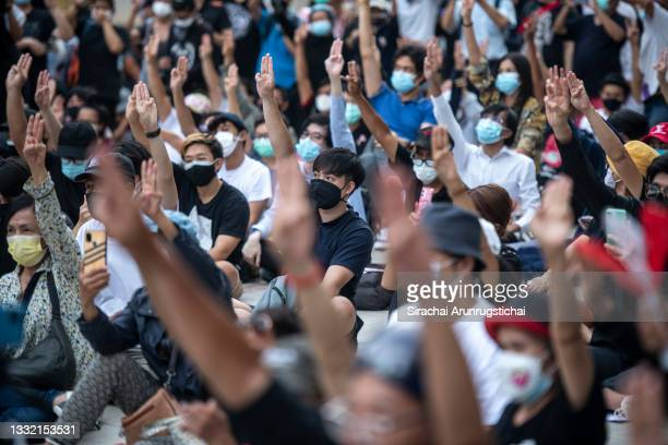 Protesters give the three fingers salute during the Harry Potter-themed protest at Bangkok Art and Culture Center in downtown on August 03, 2021 in...