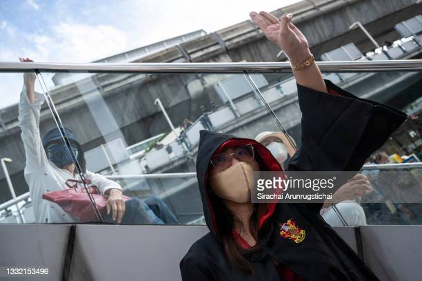 Protesters give the three-fingers salute during the Harry Potter-themed protest at Bangkok Art and Culture Center in downtown on August 03, 2021 in...