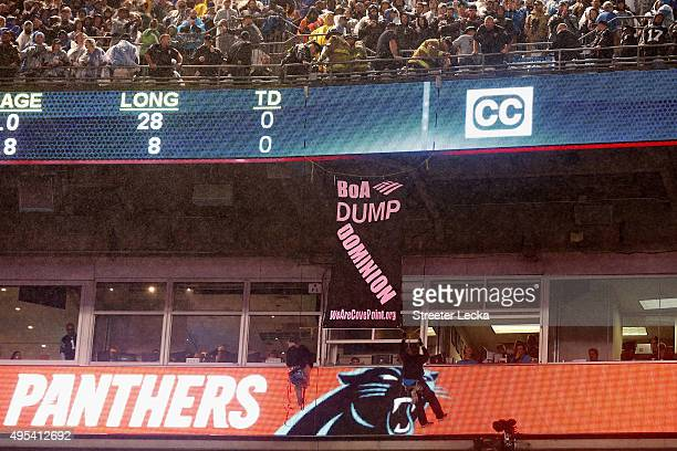 Protesters hang from the railings during the Carolina Panthers versus Indianapolis Colts Monday Night Football game at Bank of America Stadium on...