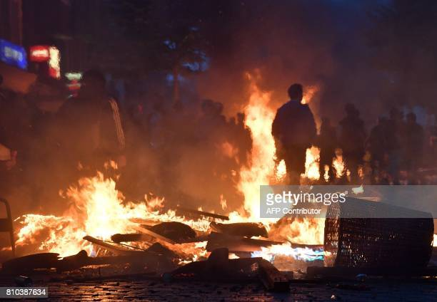 Protesters have set barricades alight on July 7, 2017 in Hamburg, northern Germany, where leaders of the world's top economies gather for a G20...