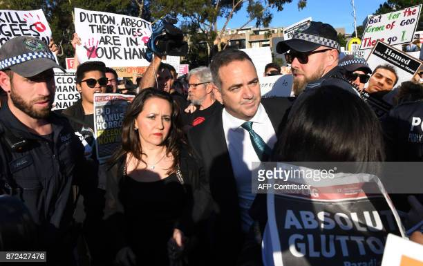 Protesters heckle people attending a Liberal Party fundraiser in Sydney on November 10 as the protesters call on the ruling Liberal coalition...