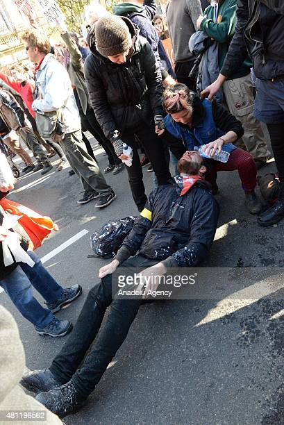 Protesters help a man who was affected by pepper gas sprayed by police during clashes between antiracism and antiIslam protesters in Melbourne...
