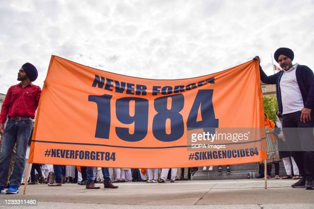 Protesters hold a 1984 banner in Trafalgar Square during the rally. Demonstrators gathered in Central London for the 1984 Sikh Massacre Remembrance...