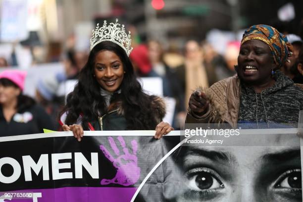 Protesters hold a banner as they participate in the Women's March against US President Donald J Trump on 6th Avenue of New York United States on...