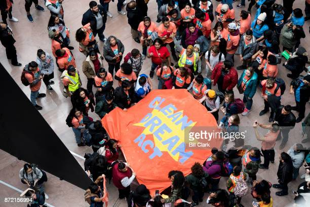 Protesters hold a banner demanding a clean Dream Act in the Hart Senate Office Building on Thursday Nov 9 2017 Protesters hung large banners from the...