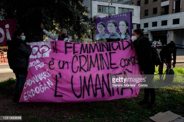 Protesters hold a banner during a demonstration of the feminist movement and the Kurdish people against Turkey's decision to withdraw from the...