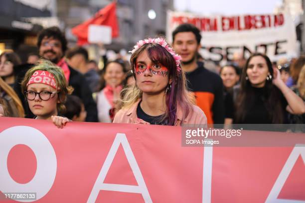 Protesters hold a banner during the no to the reform march in Montevideo. People march against the constitutional reform project which proposes a...