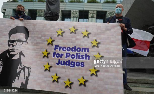 Protesters hold a banner in front of the Supreme Court in Warsaw, Poland on June 8, 2020 in support of Judge Igor Tuleya, an outspoken critic of the...