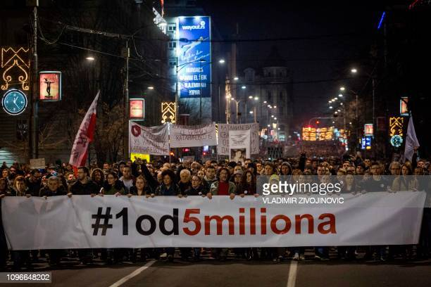 Protesters hold a banner reading '1 out of 5 millions' during a demonstration against Serbian in Belgrade, Serbia, on February 9, 2019. - Every...